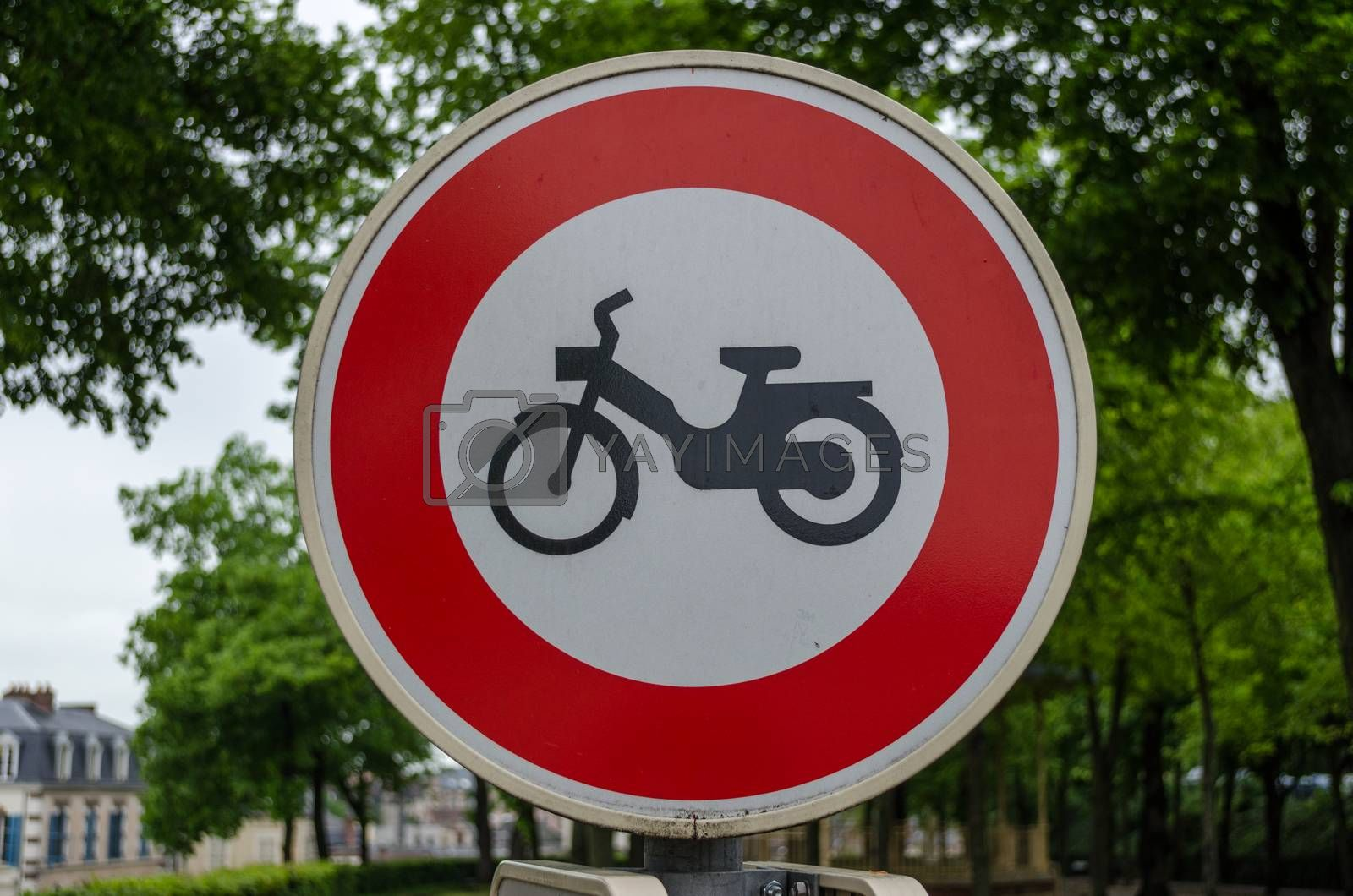 Raod sign which bans the use of mopeds or motorbikes on a road in France