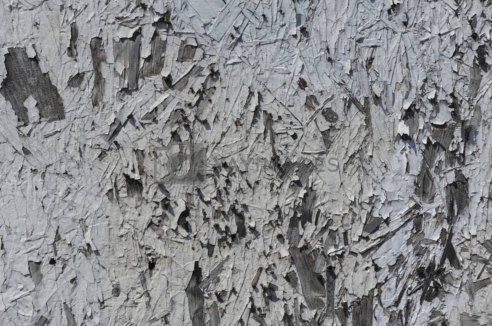 Textured painted wood with cracked and peeling paint