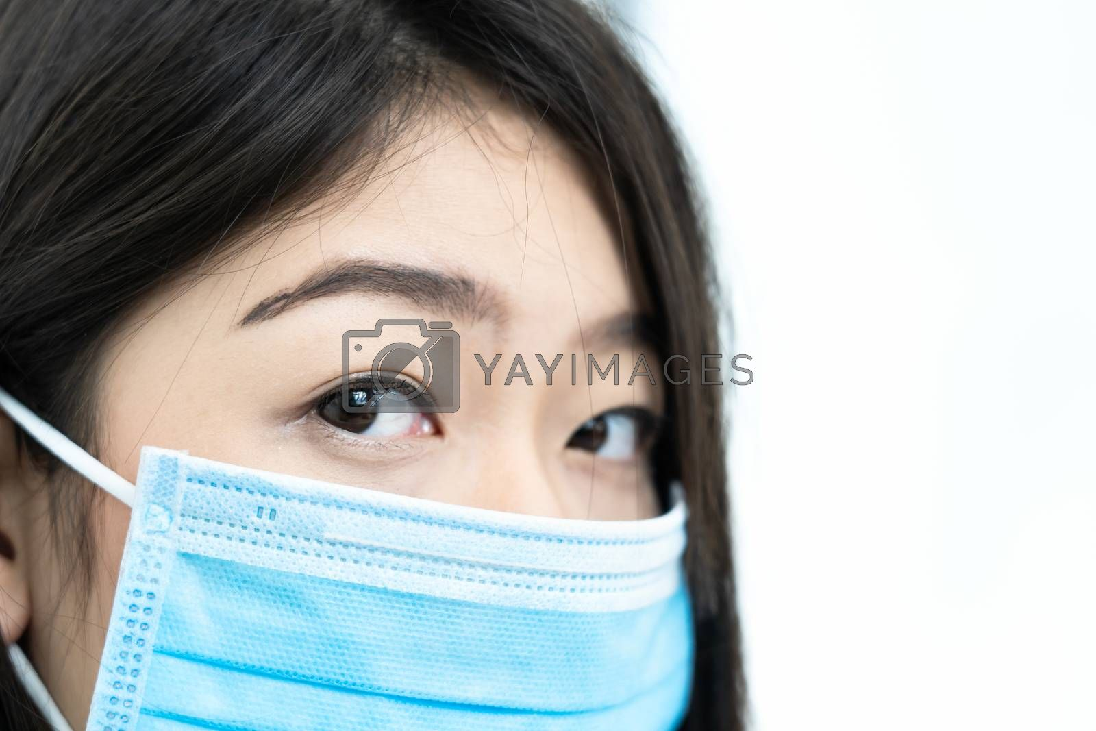Close up woman with headache wearing  protective mask  for protection against virus Covid-19