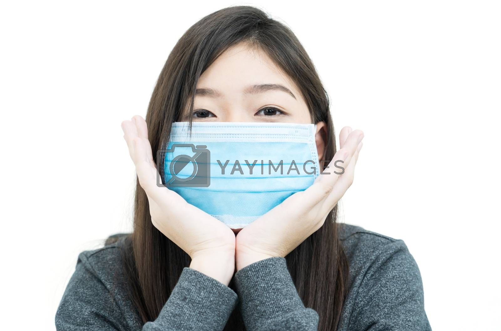Close up woman long hair propping up chin with his hands and wearing protective mask for protection against virus Covid-19 on white