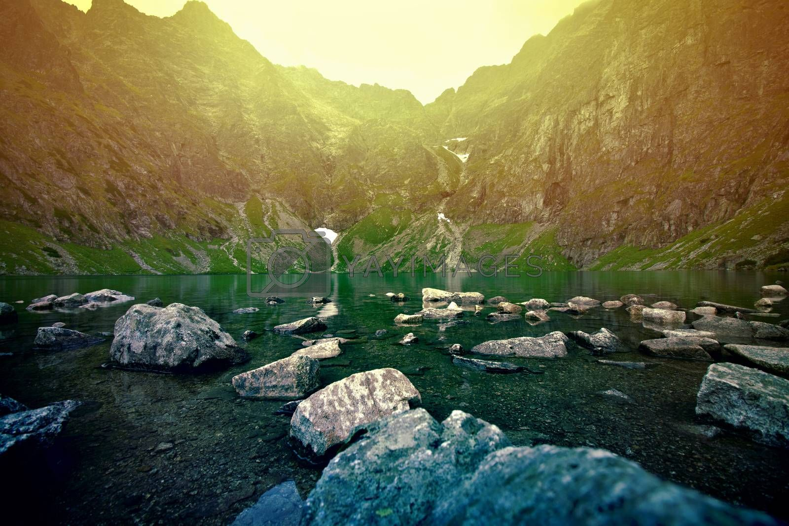 Sunset over lake in mountains. Nature concept.