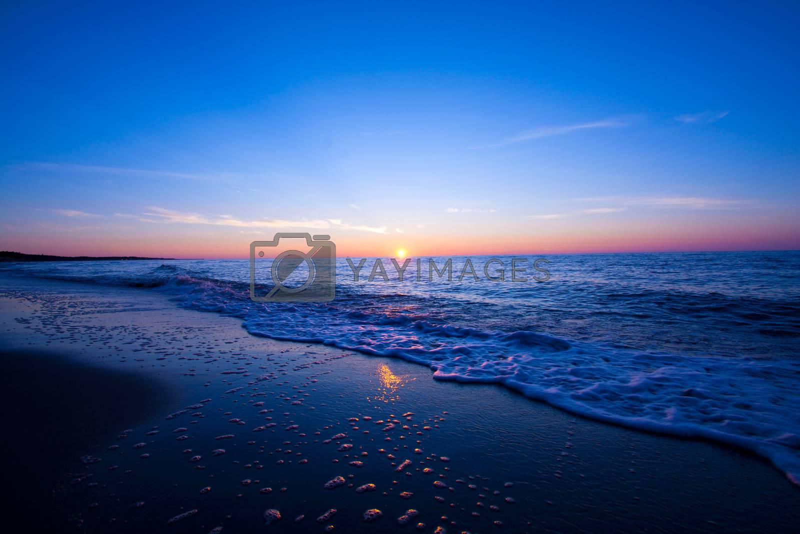 Sunset over sea. Blue nature fantasy marine landscape.
