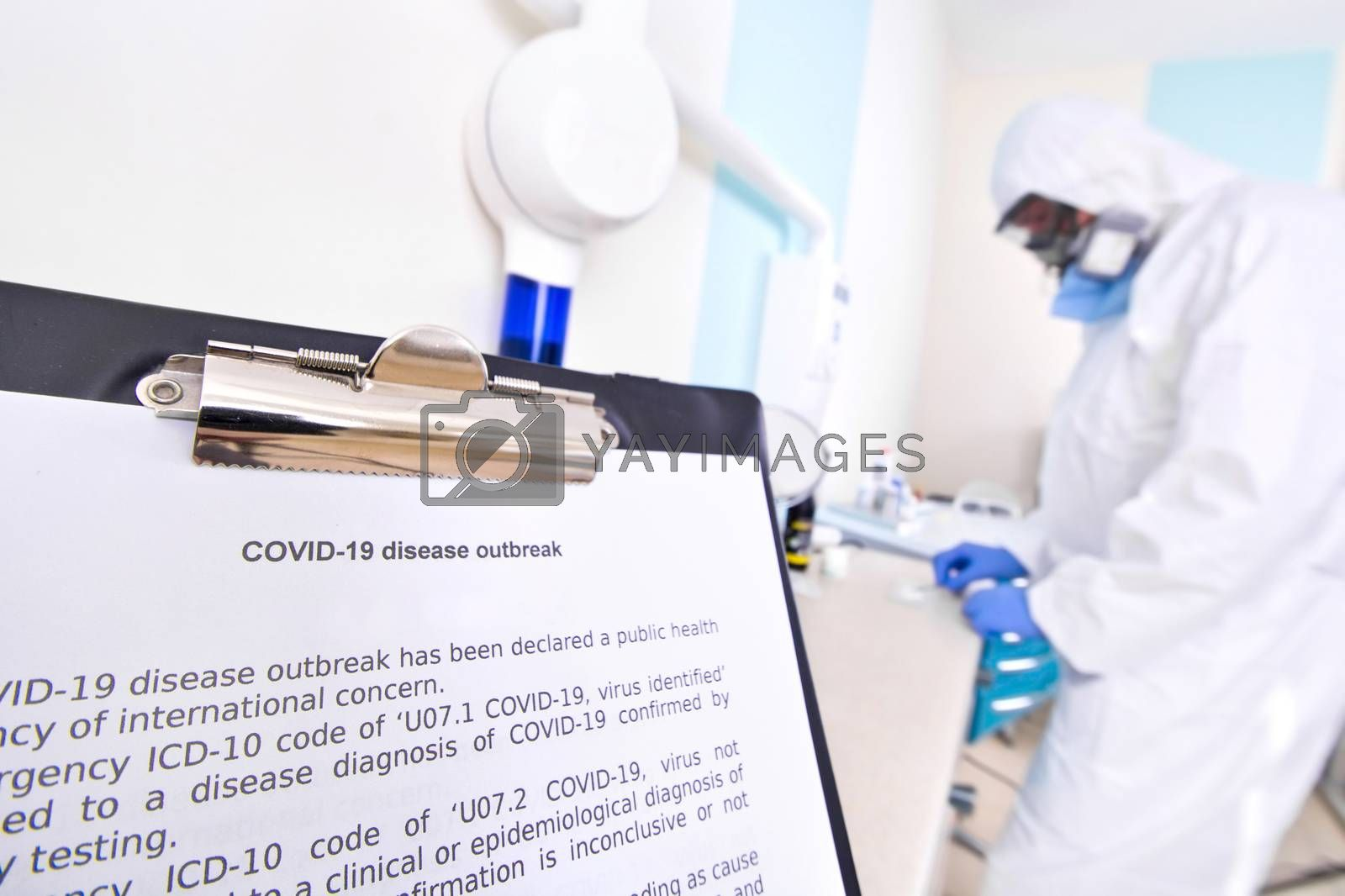 Doctor in protective suit uniform and mask in laboratory. Coronavirus outbreak. Covid-19 concept.