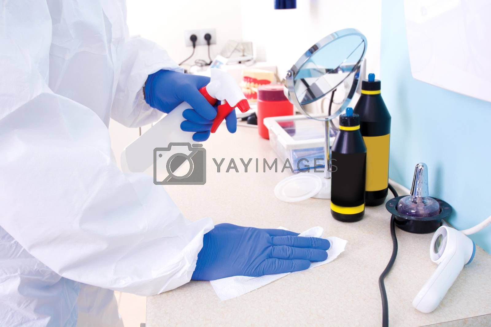 Doctor in protective suit uniform cleans the laboratory. Coronavirus outbreak. Covid-19 concept.