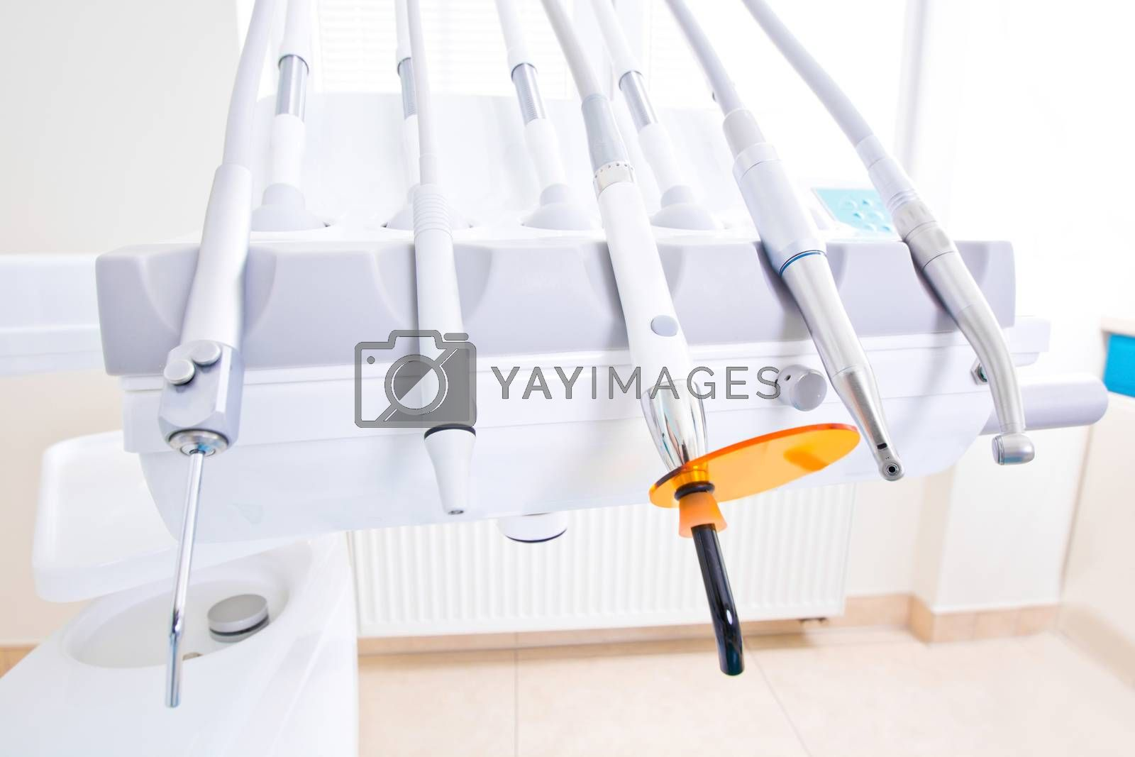 Professional Dentist tools in the dental office. Dental Hygiene and Health conceptual image.