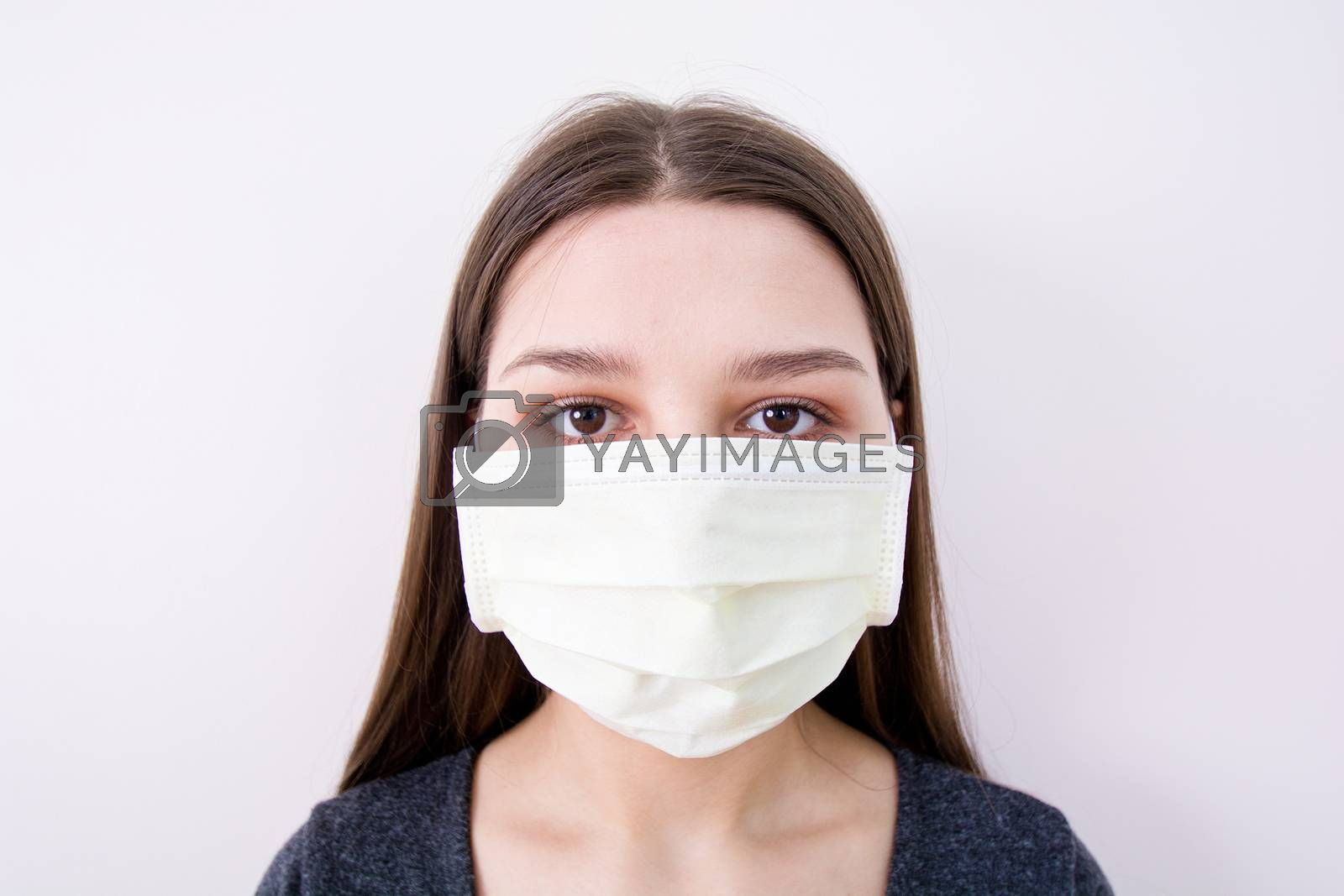 Young woman wears a face mask. Isolated image. Covid-19 concept.