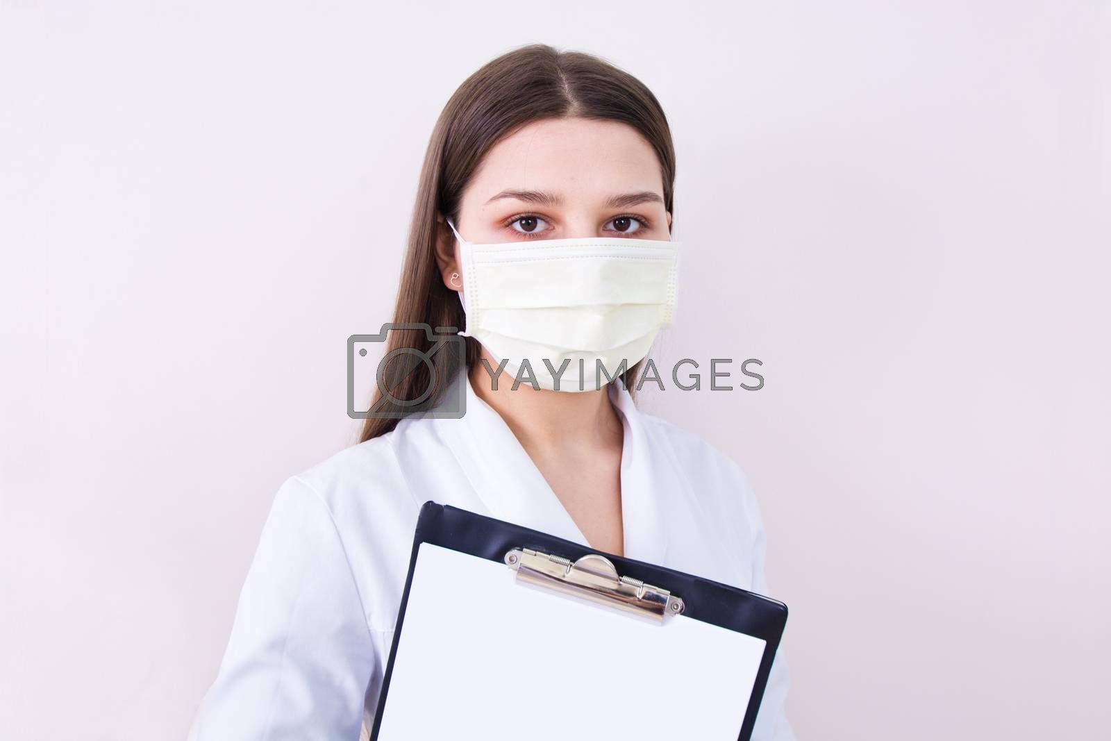 Female doctor wearing protection face mask. Covid-19 concept.