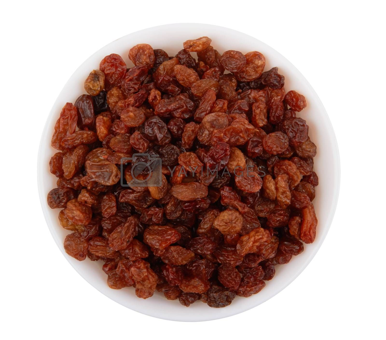 Raisins in bowl isolated on a white background