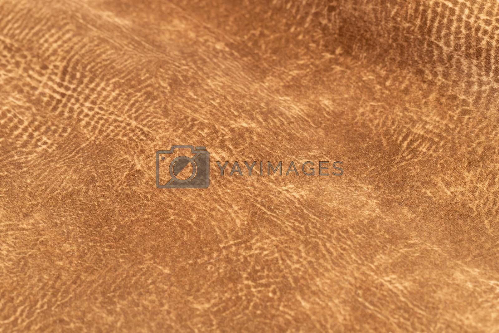 brown faux suede leather for the concept and style idea of fine leather craft, handmade work space. Background textures and Wallpapers.