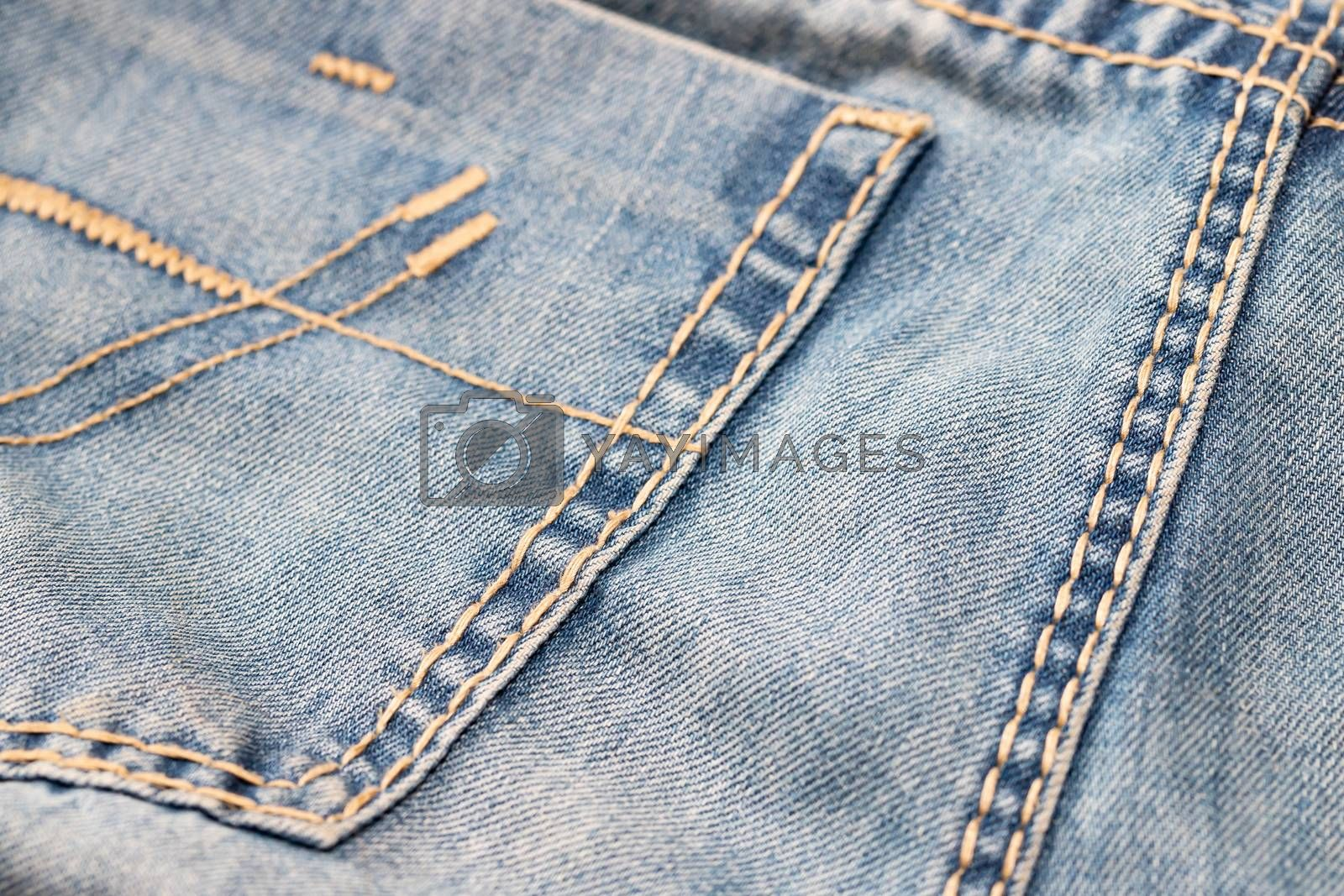 Close-up of blue denim texture. Denim jeans background, space to copy your design or text.
