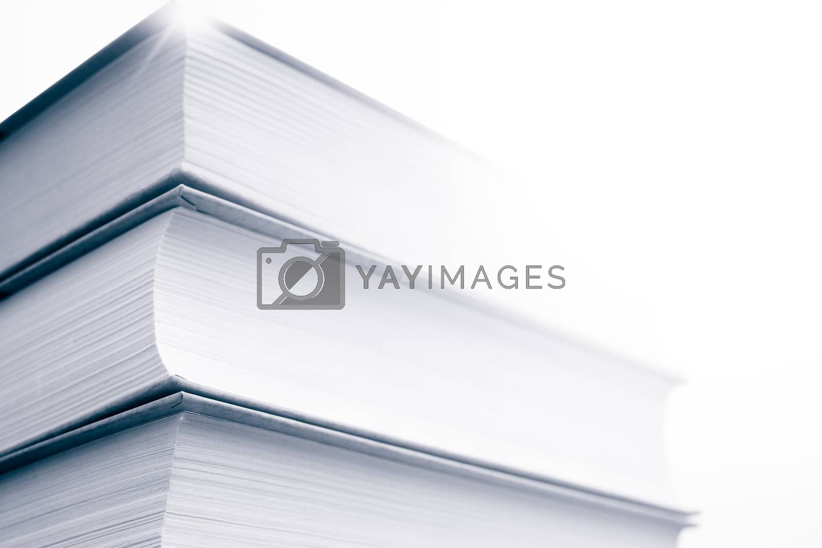 Thick paper books are a symbol of education and wisdom. A stack of books on the table. Storage and dissemination of information.