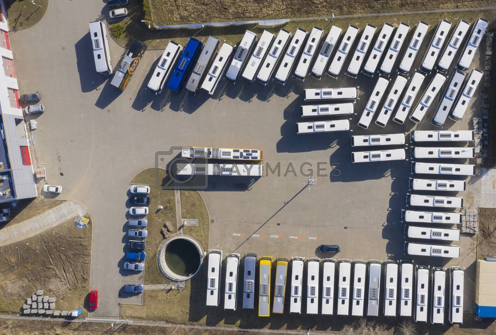 Royalty free image of Aerial view to parking lot for autobus and trucks. Industrial ba by jackald