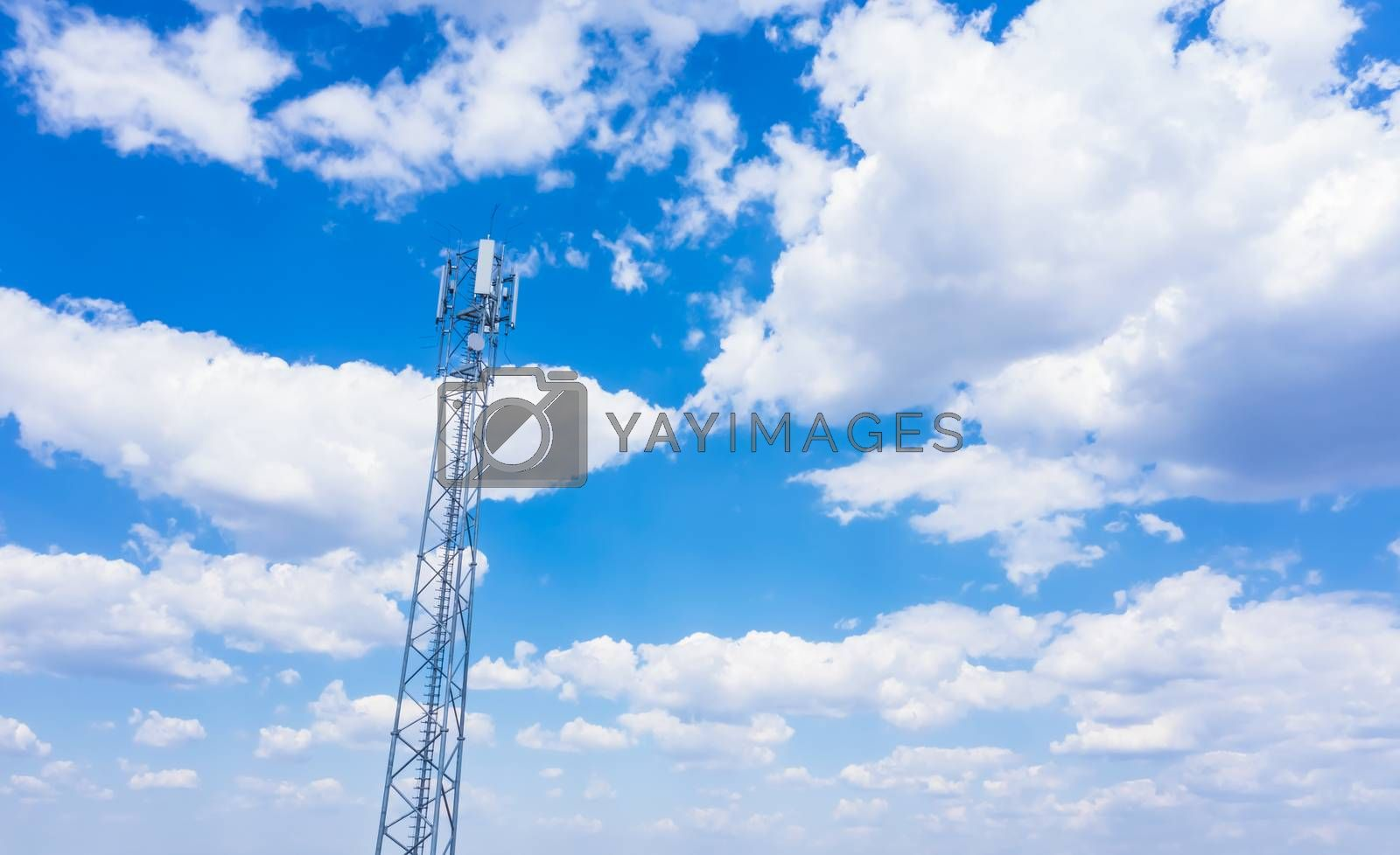 Telecommunication tower of 4G and 5G cellular. Cell Site Base Station. Wireless Communication Antenna Transmitter. Telecommunication tower with antennas against blue sky background.