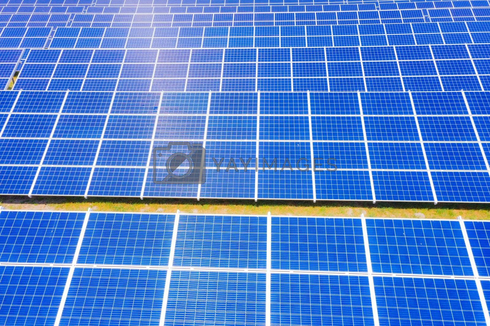 solar panels with the sunny sky. Blue solar panels. background of photovoltaic modules for renewable energy. Aerial view of Solar panels Photovoltaic systems industrial landscape