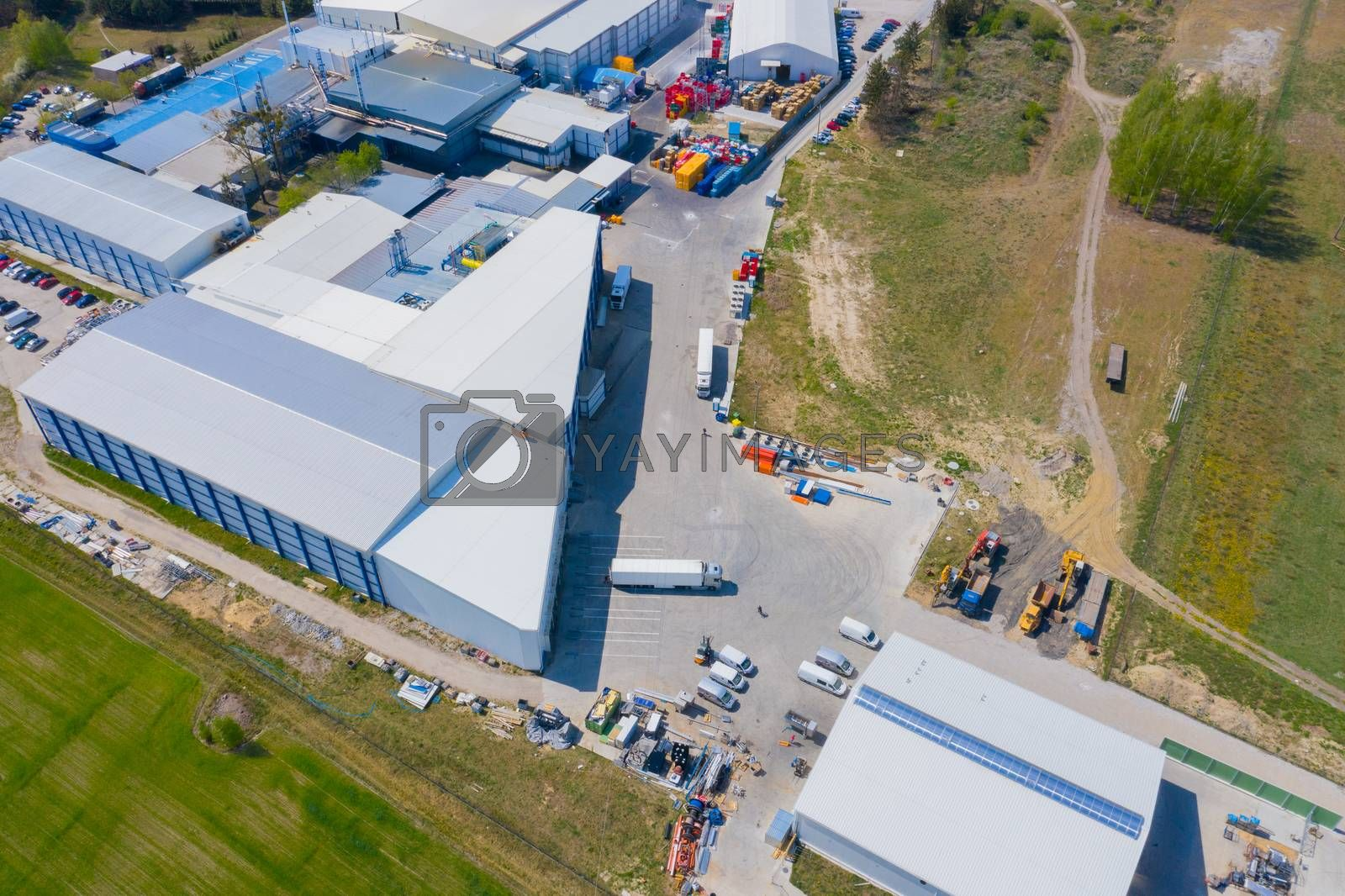 Aerial view of goods warehouse. Logistics center in industrial c by jackald