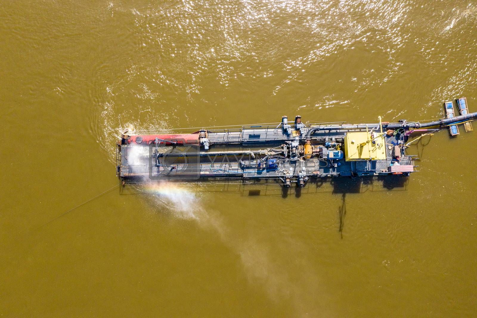 Water pump on the river bank on a big boat. Aerial view