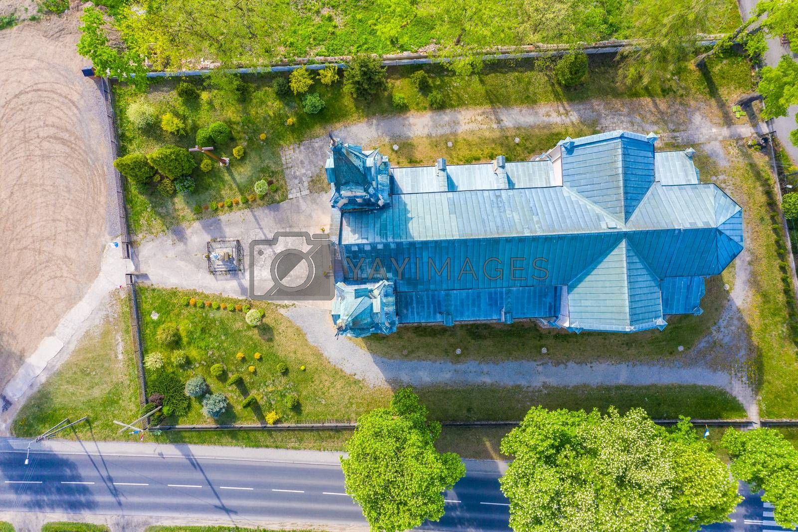 Aerial photo of a Catholic Church. Green. Spring time