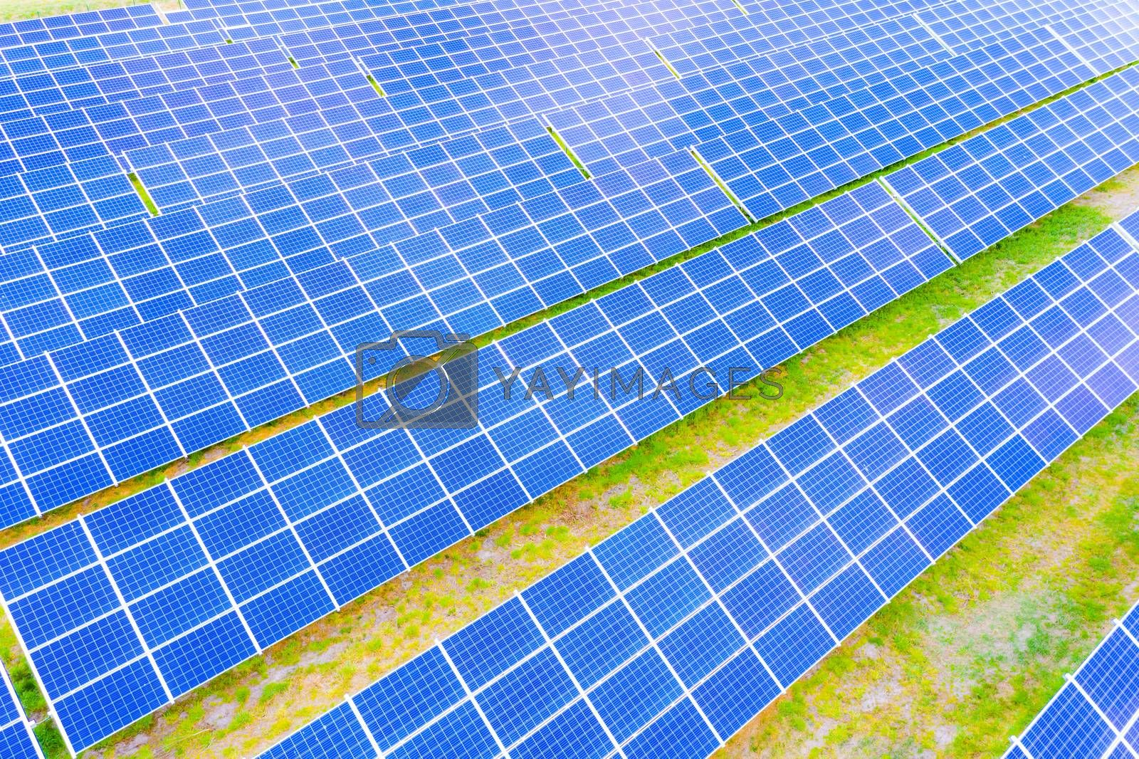 power solar panel on blue sky background,alternative clean green energy concept. Aerial view of Solar panels Photovoltaic systems industrial landscape