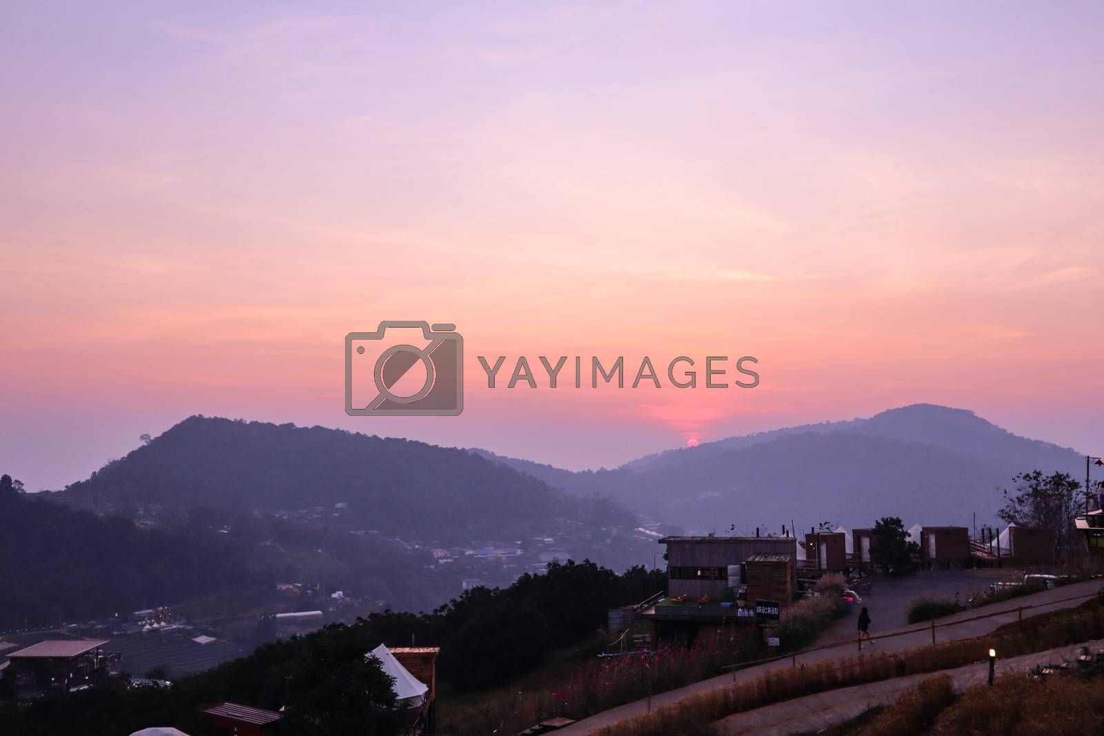 The sunset in a thai village near mountains in Chiang Mai, Thailand. The mountain scenery view