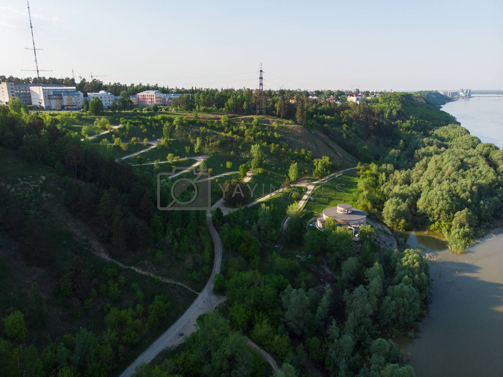 Aerial top vew of winding road in the city by rusak