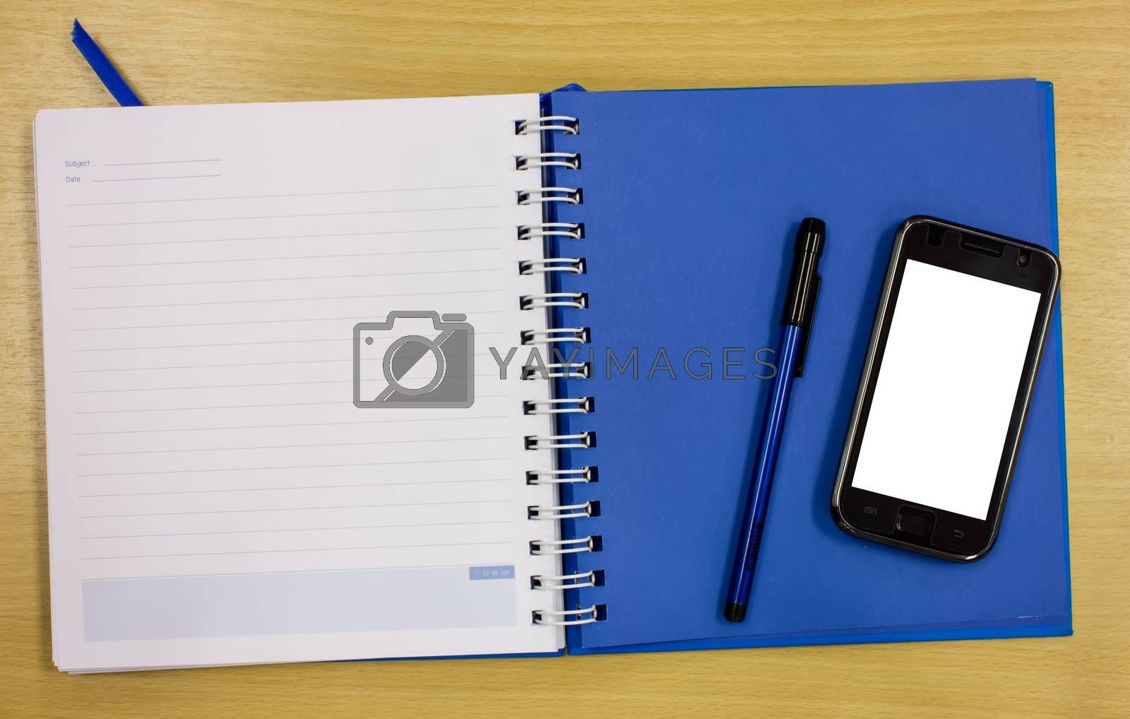 mobile phone blue diary book on table office