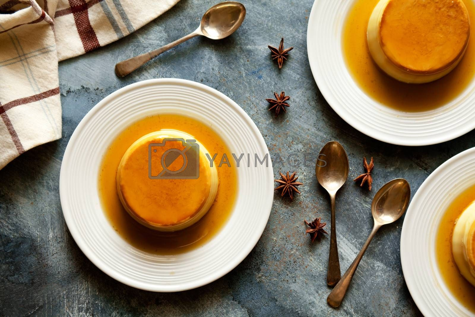 Small homemade sweet caramel pudding close up
