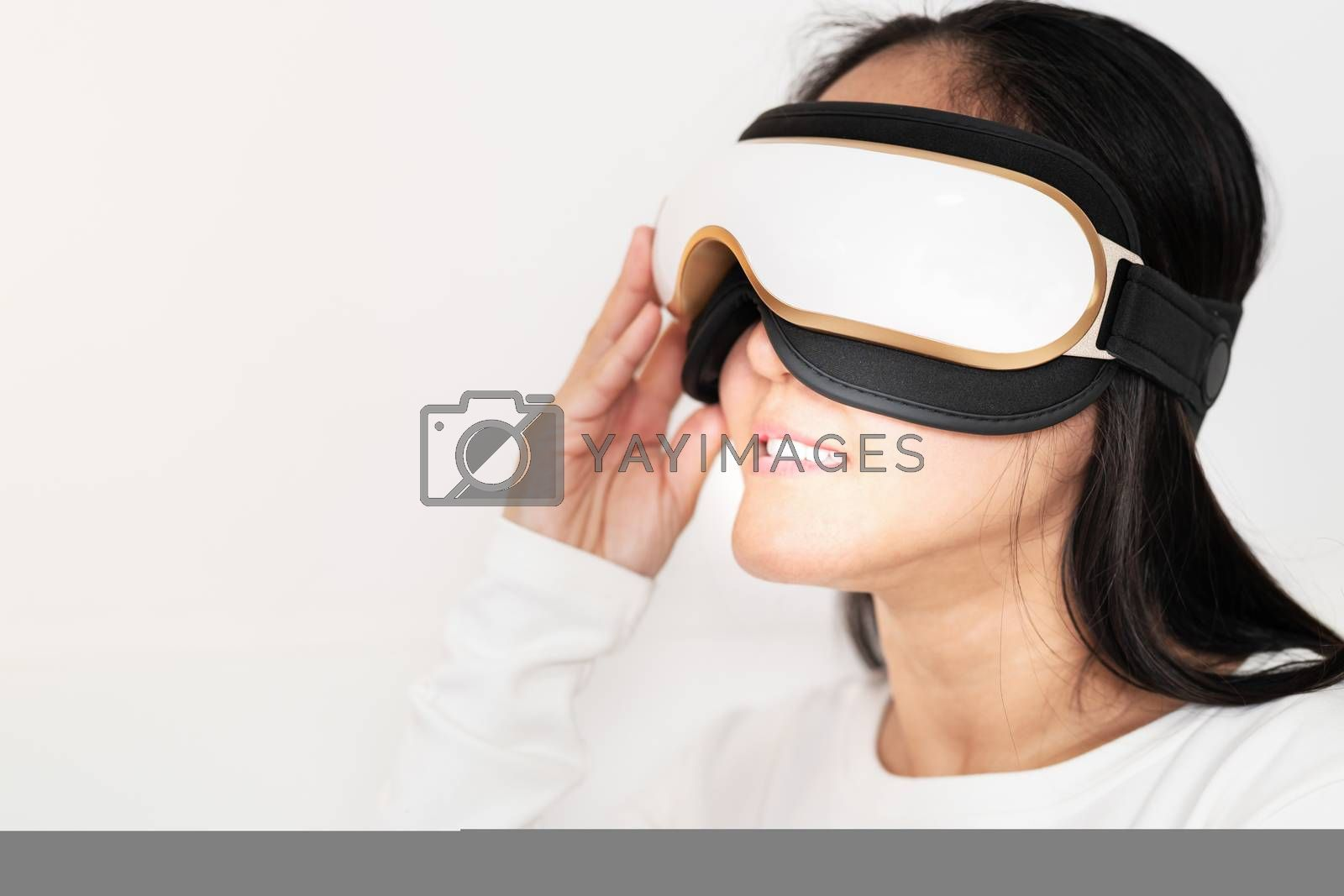 relax and massage, electric eye massage machine on women, closeup, healthcare and medicine concept