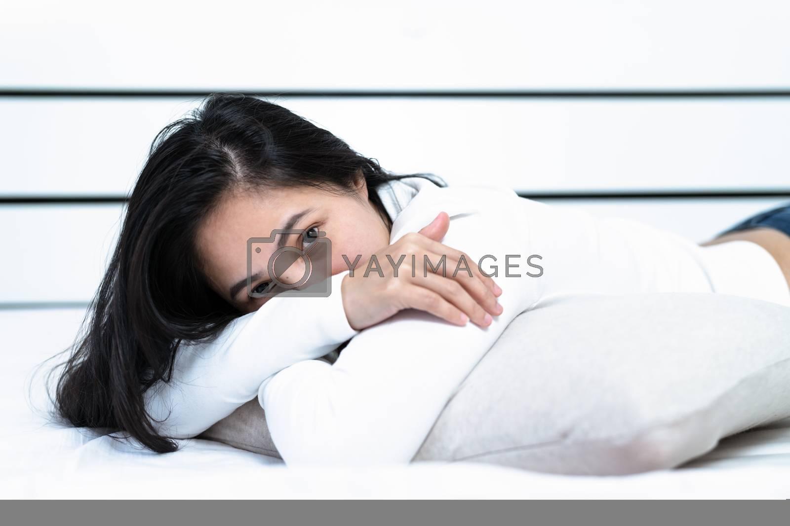 woman lying on pillow in bedroom, portrait happy women look at camera
