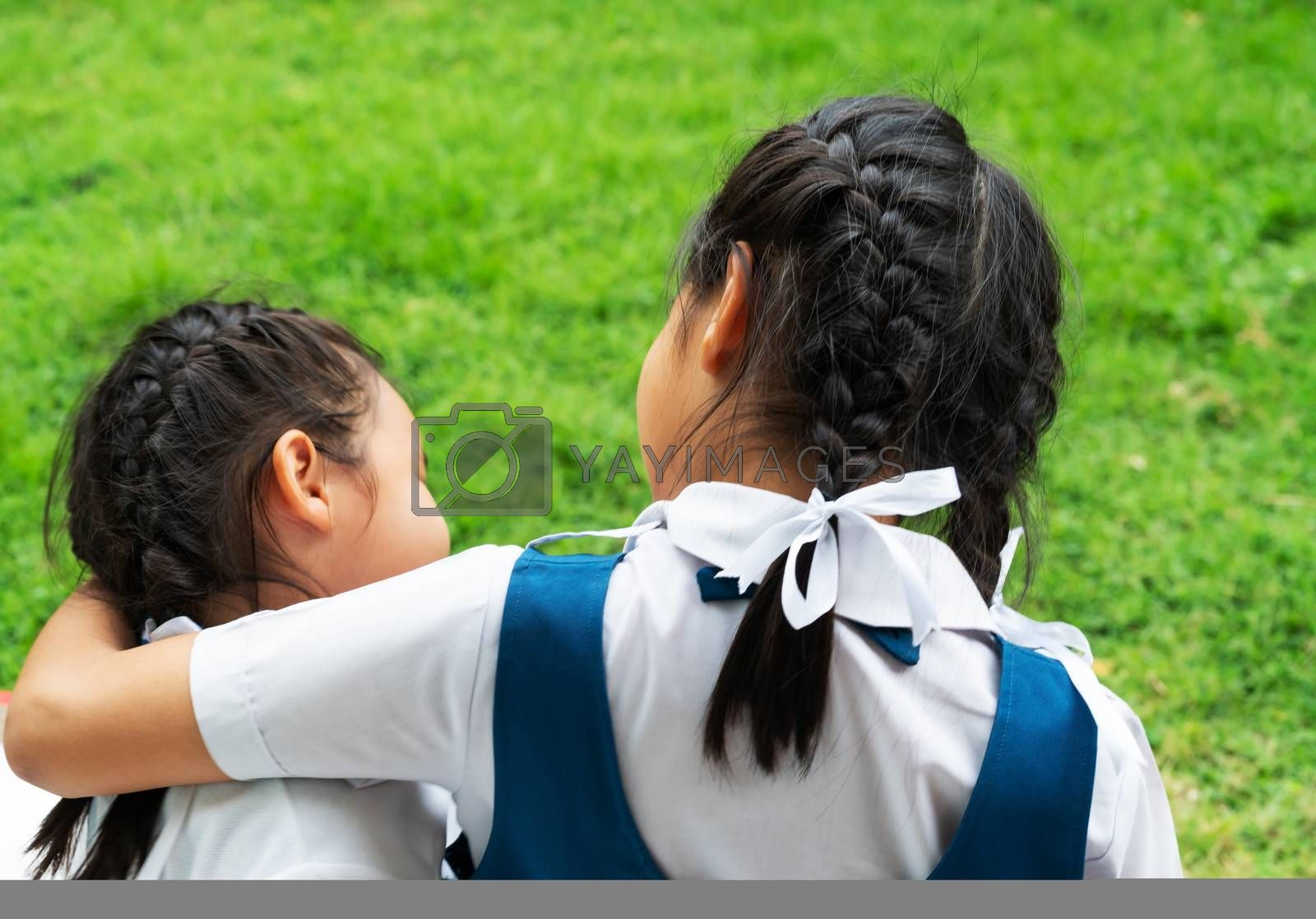 two little asian girls sisters hugging happy post in school uniform, back to school concept