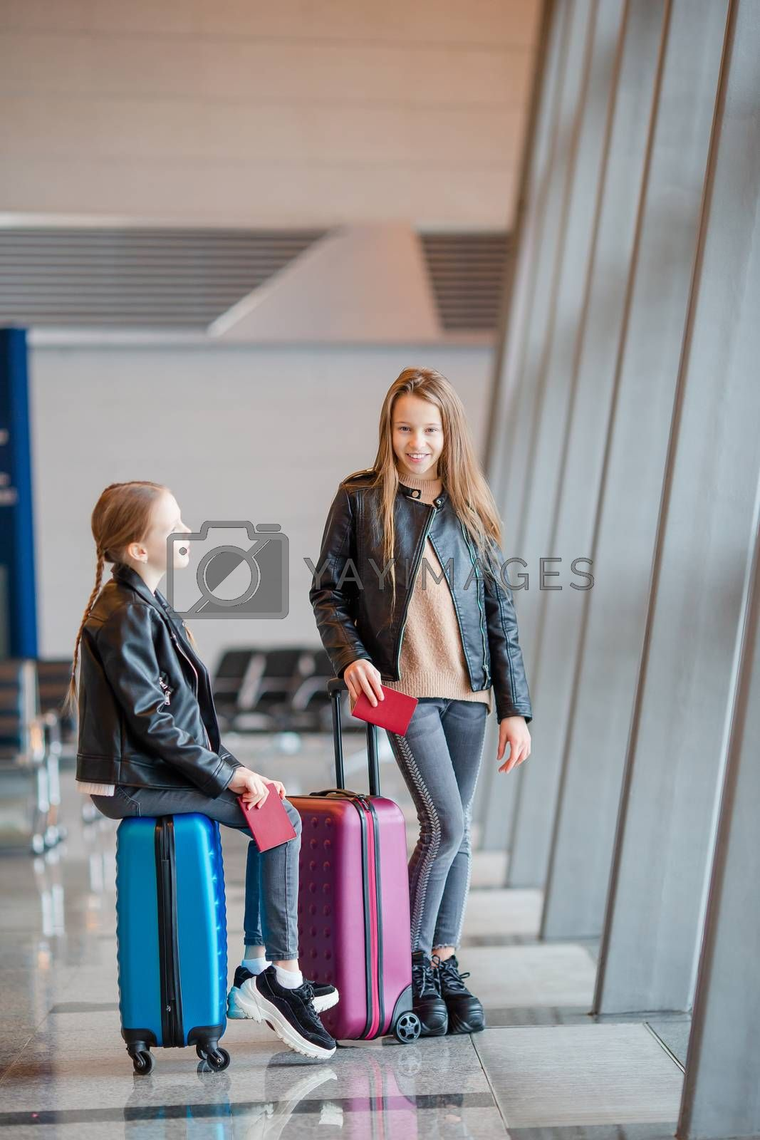 Little adorable kids in airport waiting for boarding indoors