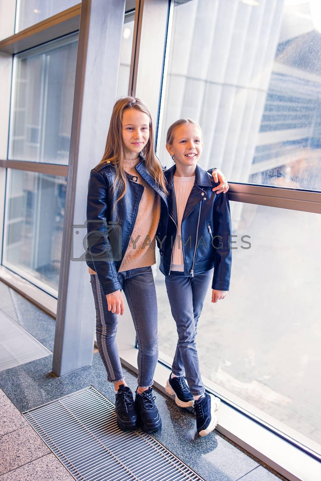 Little adorable kids in international airport having fun