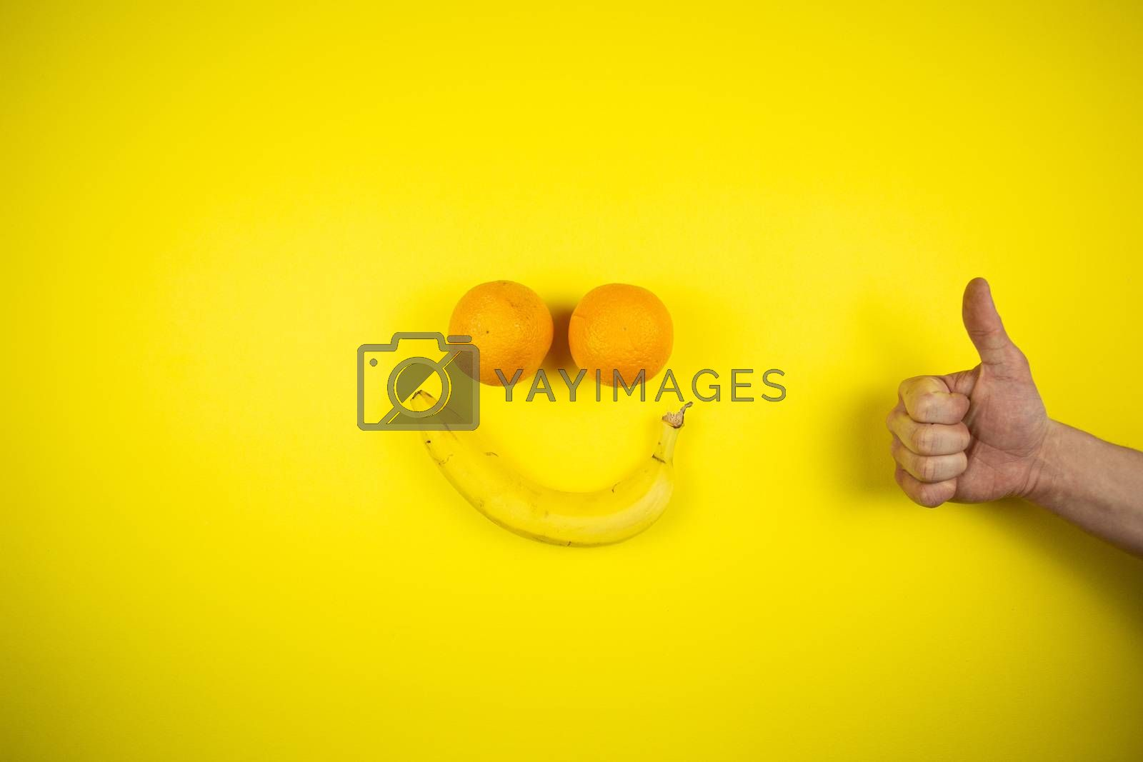 banana and oranges in the form of a smile, fruits