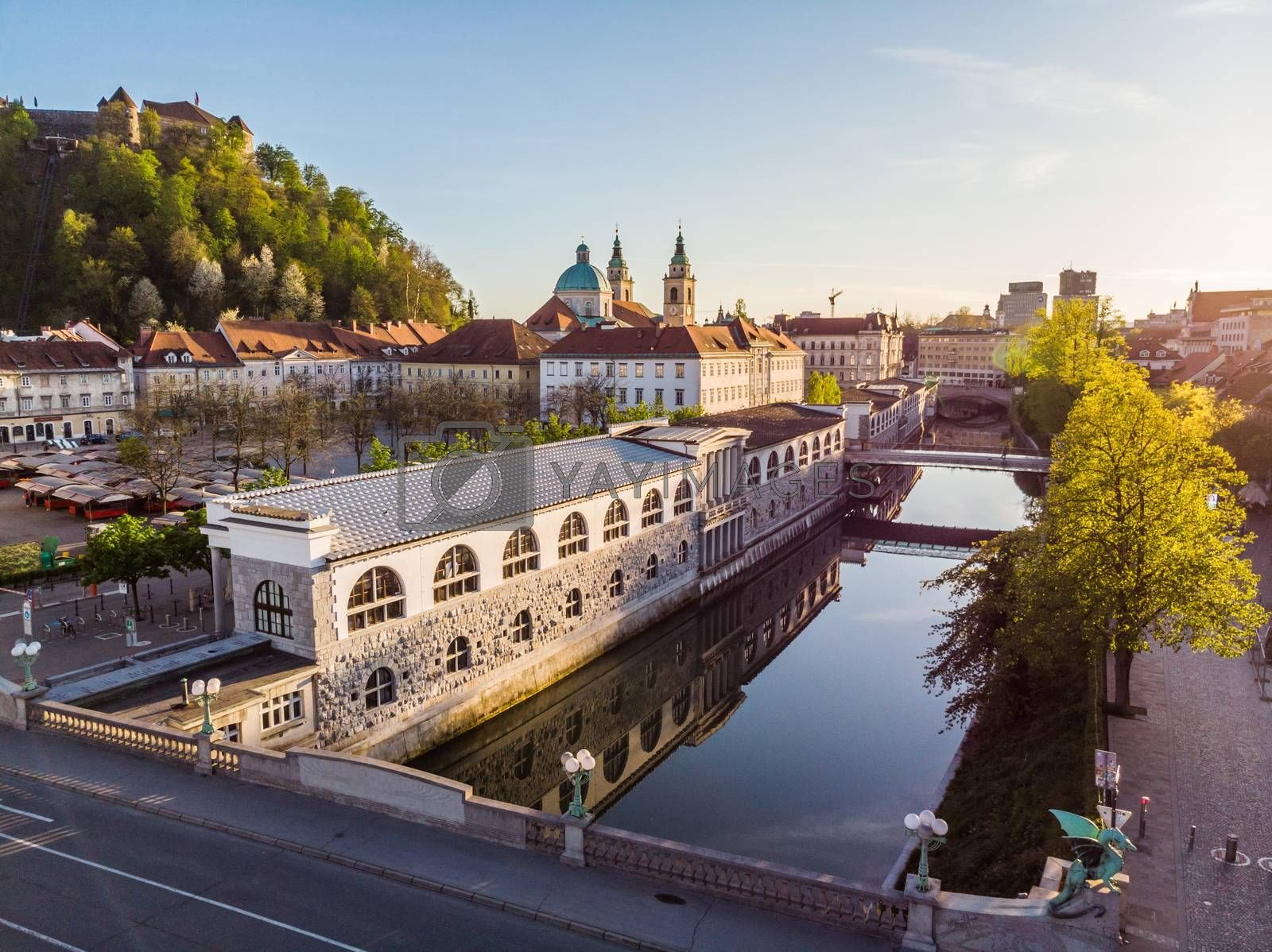 Aerial drone panoramic view of Ljubljana medieval city center, capital of Slovenia in warm afternoon sun. Empty streets during corona virus pandemic social distancing measures.