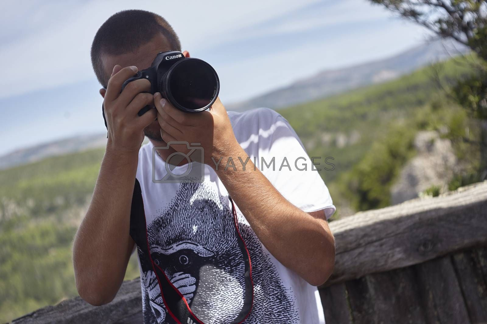 Photographer in nature in action during a sunny day