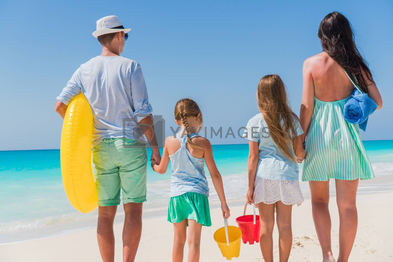 Young family on vacation on the beach. Family travel concept