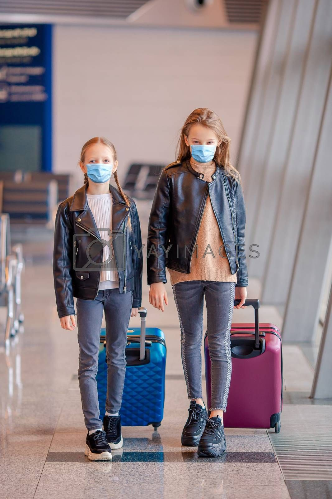 Little adorable kids in international airport with boarding pass