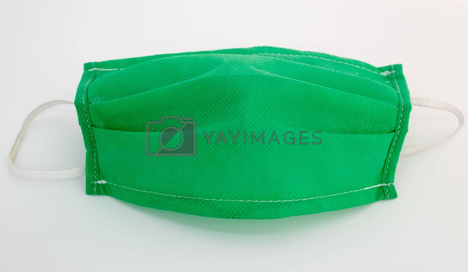 green medical face mask on a white background