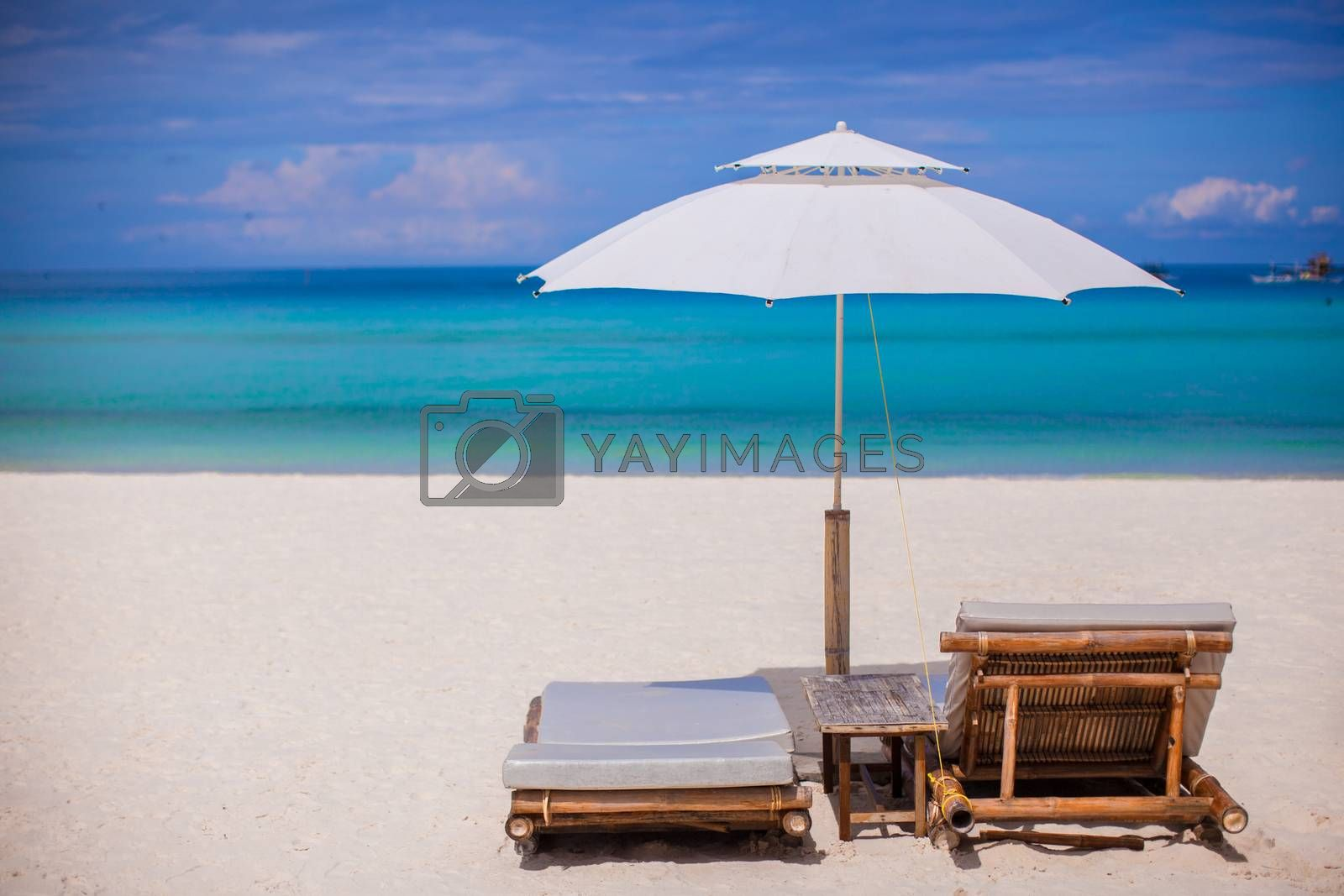 Beach wooden chairs for vacation on tropical beach