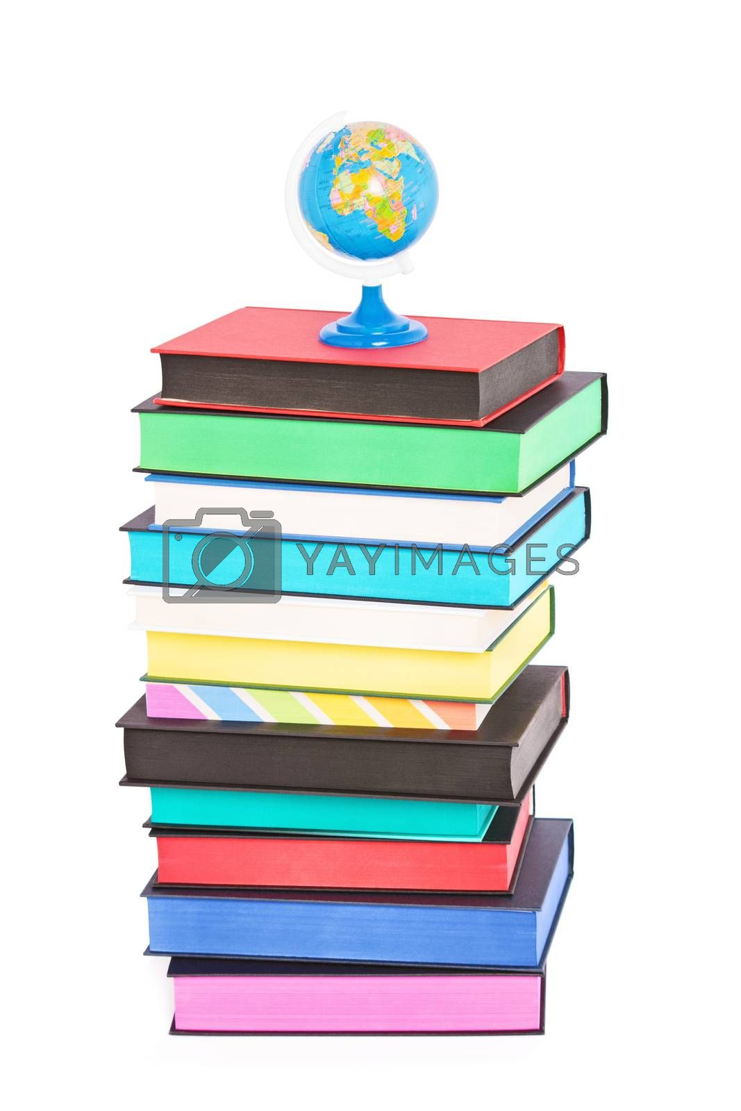 A globe on top of stack of colorful books with different sprayed edges, isolated on white background. Education and travel concept.