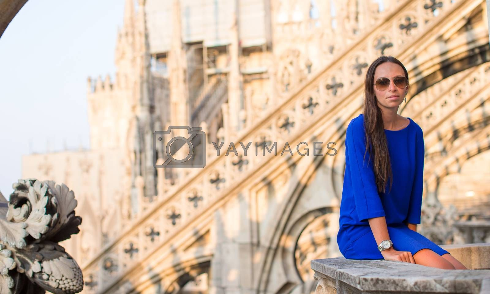 Beautiful woman on rooftop of Duomo, Milan, Italy