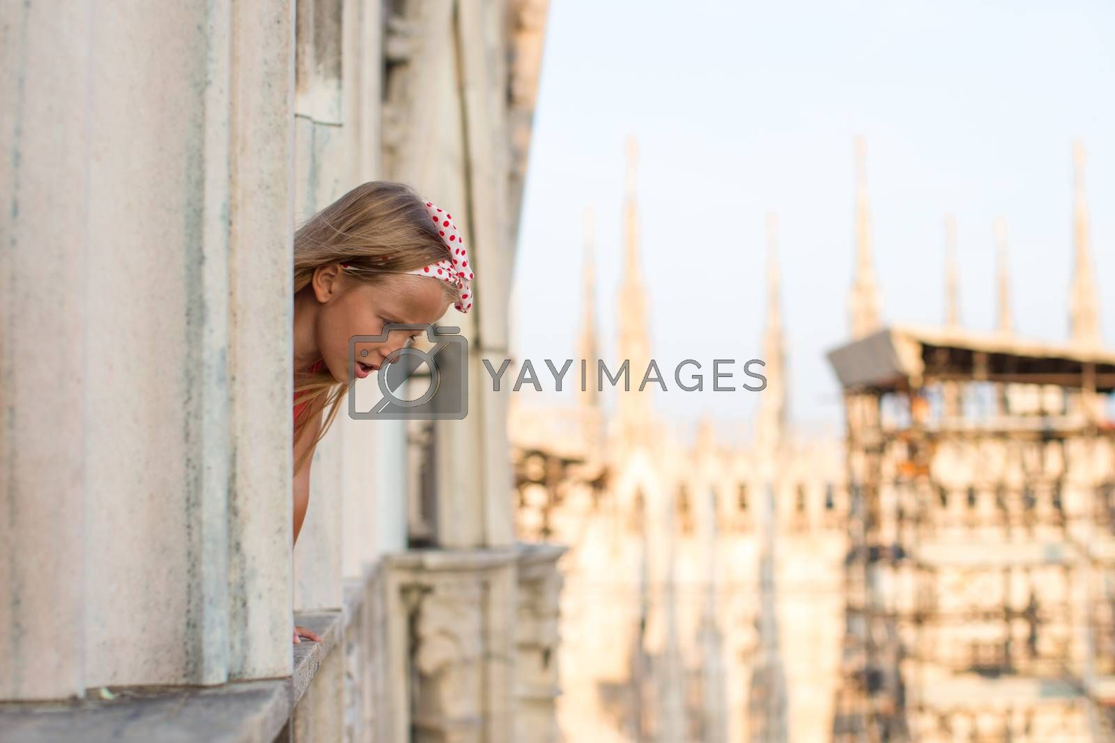 Adorable little girl on the rooftop of Duomo, Milan, Italy by travnikovstudio