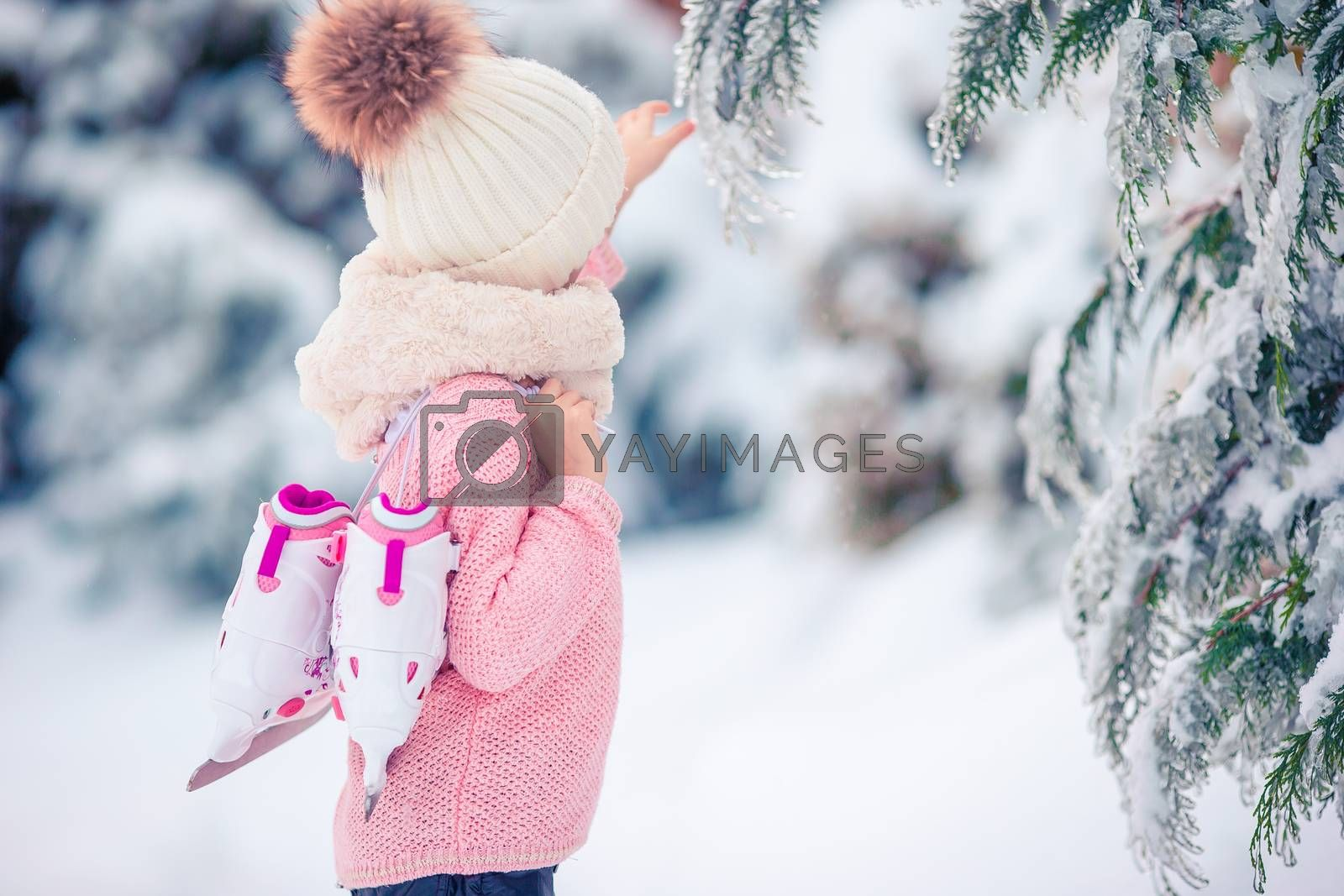 Cutest little girl going to skate in winter snow day outdoors