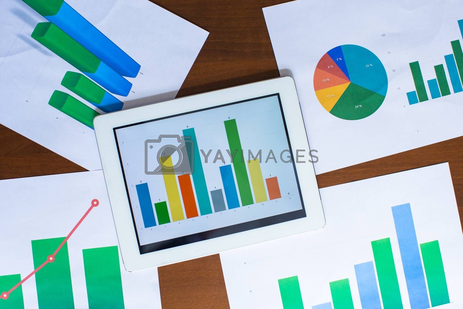 Business chart showing financial success on paper by travnikovstudio