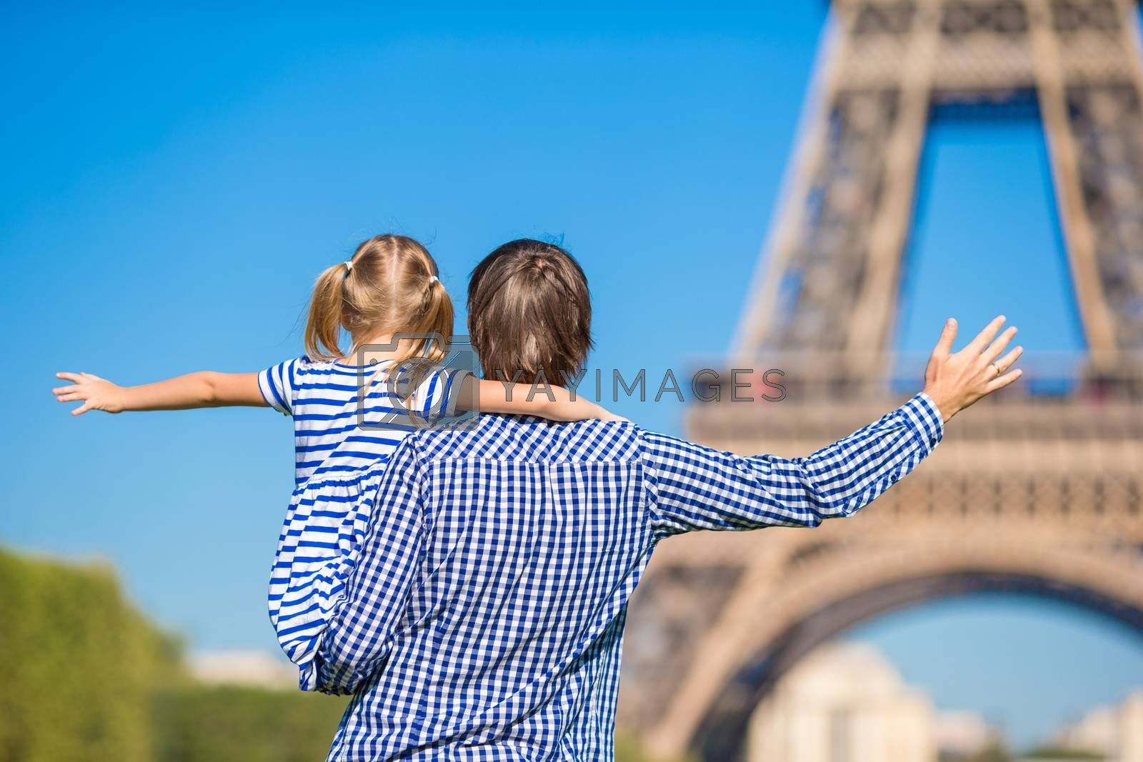 French summer holidays, travel and people concept - happy family in Paris background Eiffel Tower by travnikovstudio