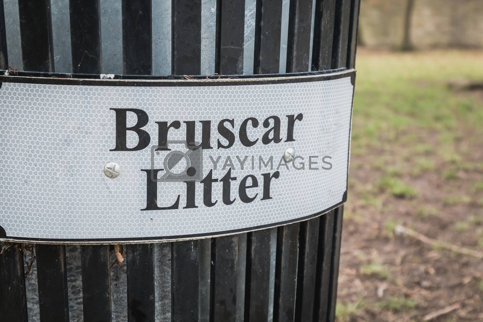 Trash timber litter bin Bruscar in a public park in Ireland near Dublin