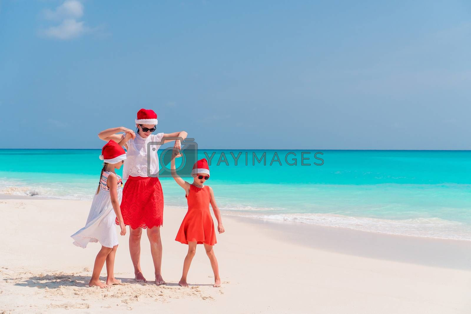 Family of mom and kids celebrating Christmas vacation