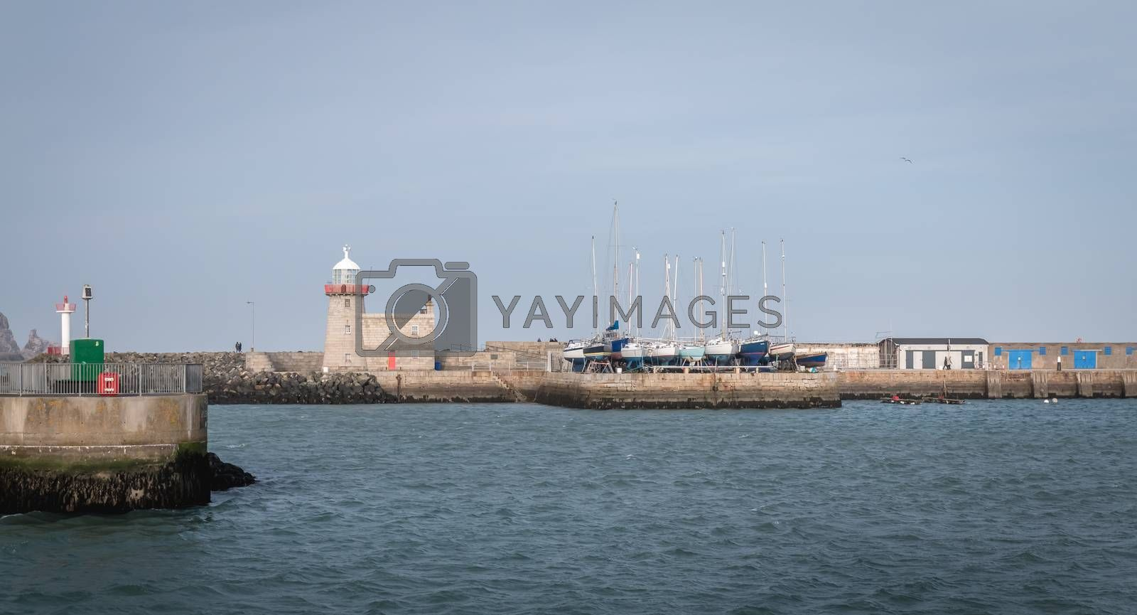 Howth near Dublin, Ireland - February 15, 2019: view of the fishing port of the city where are parked professional fishing boats on a winter day