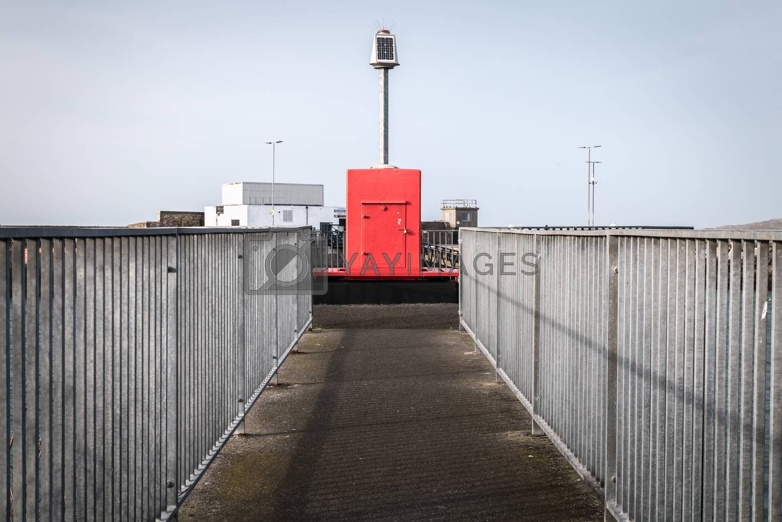Howth near Dublin, Ireland - February 15, 2019: Illuminated signal for boat guidance at the entrance to Howth harbor on a winter day