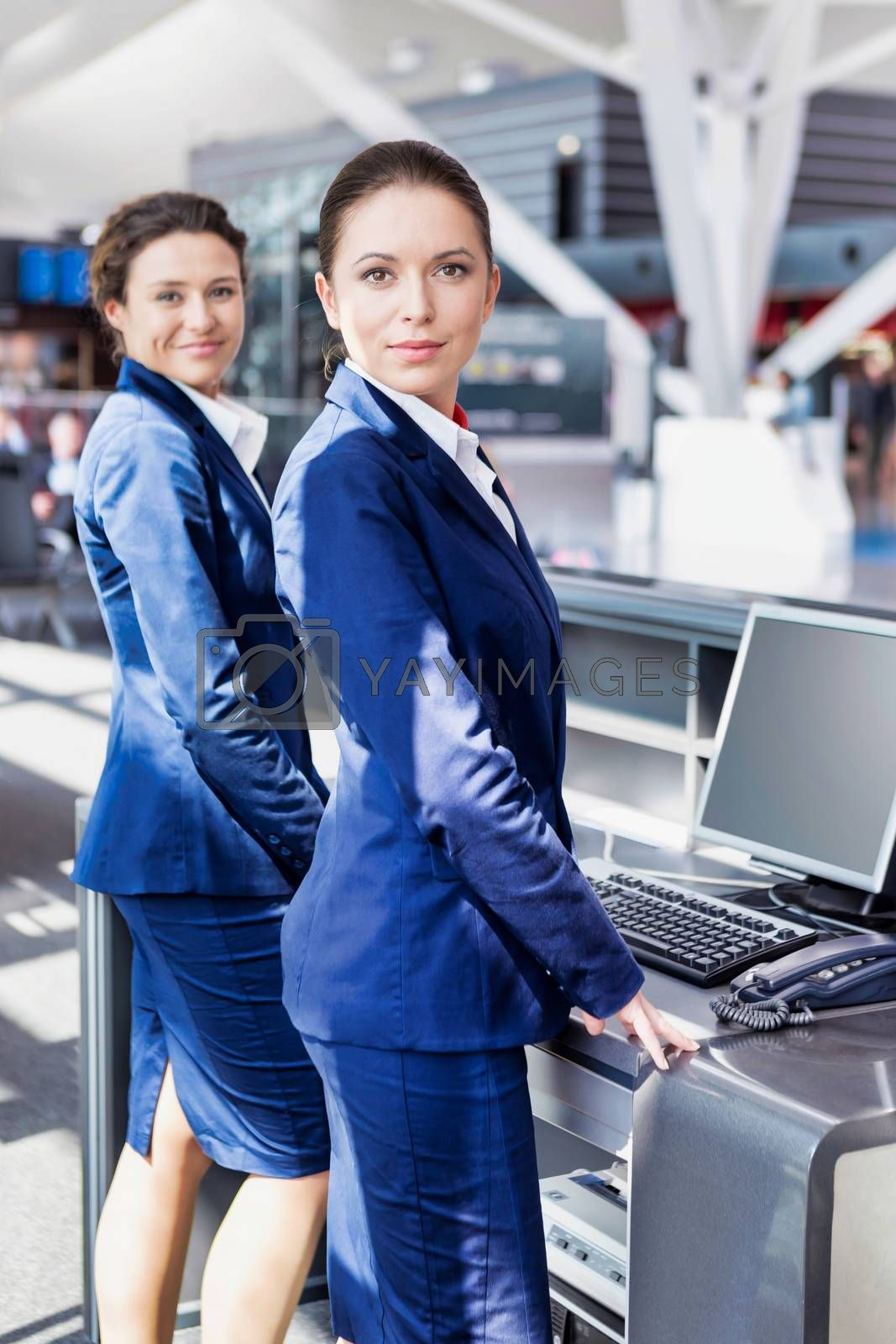 Portrait of young attractive passemger service agent standing in airport