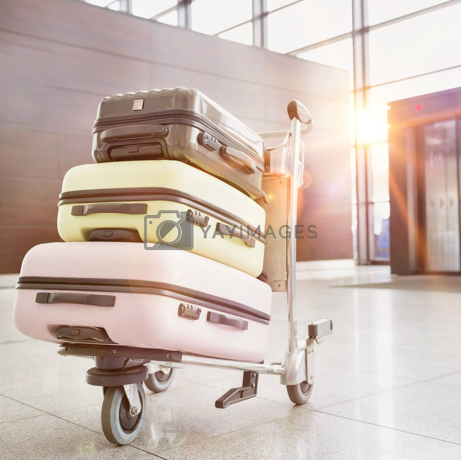Photo of baggage on cart with lens flare by moodboard
